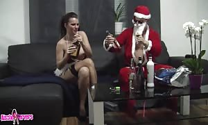 aroused Santa drills aroused dark haired with strikingly massive breasts